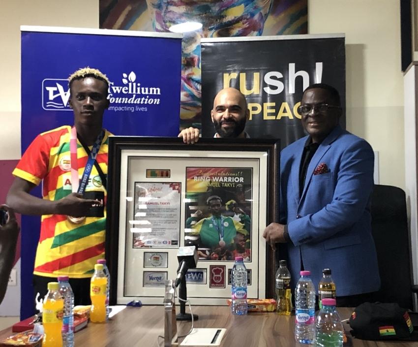 Twellium Industrial Company Limited Presents Citation To Bronze medalist Samuel Takyi